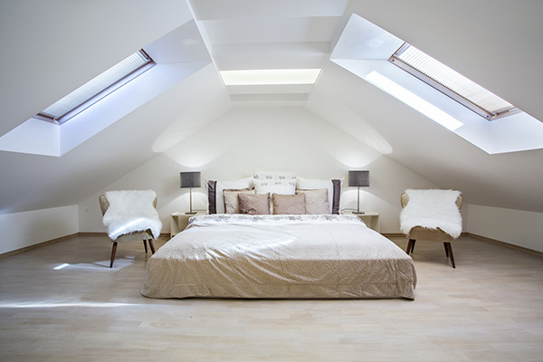 Roof loft conversions - bedroom image with chairs and soft lighting