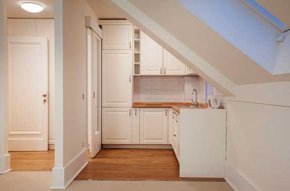 Loft conversions - White kitchen area